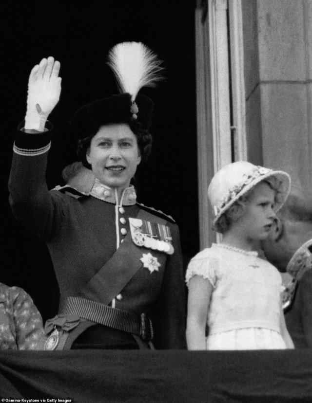 1956 — SMILE AND WAVE PRINCESS: It was back to business as usual in 1966. Pictured: The Queen salutes the troops with Princess Anne, here about six years old.