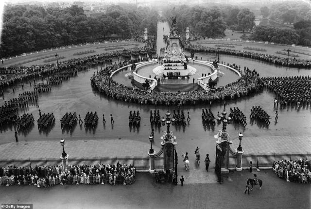 1958 — WHAT A CROWD:The Trooping the Colour ceremony outside Buckingham Palace. The Mall is in the background.