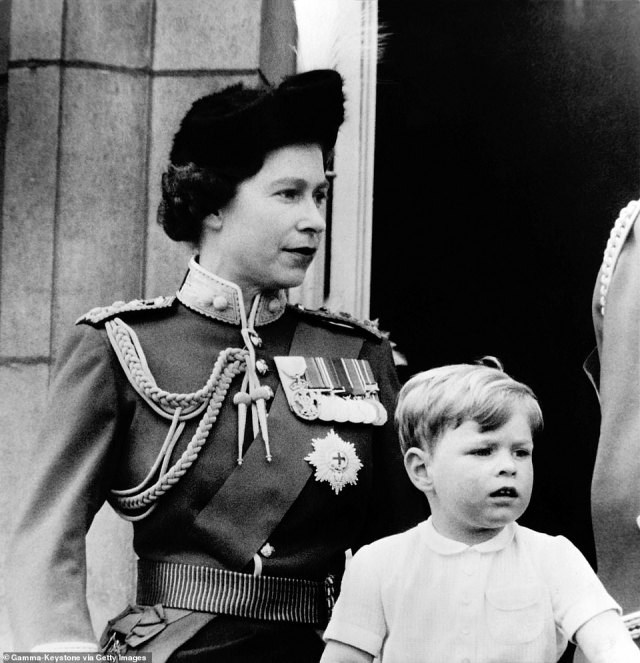 1963 — THE QUEEN'S MEDALS IN VIEW: A young Prince Andrew with his mother Queen Elizabeth II observe the Trooping the Colour ceremony from the balcony of Buckingham Palace.