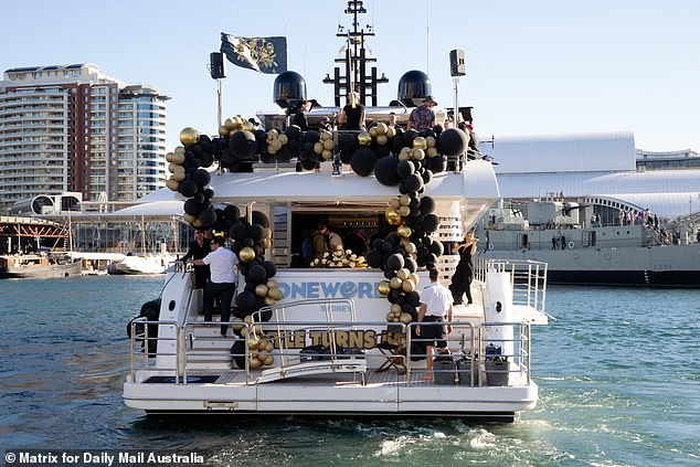 Classy motif: The vessel was decorated with an abundance of gold and black balloons