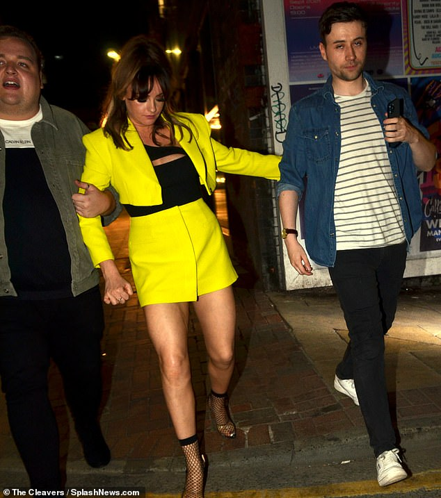 Wild night out: The former Coronation Street star, 27, left the Gorilla Bar and Restaurant following her best friend Lee Bennett's birthday. Lee is pictured on the left and on the right is Katie's publicist Shane O'Meara