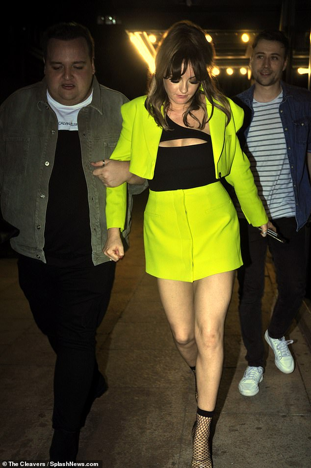 Ensemble: Just hours prior, the actress arrived at the venue, appearing in good spirits and showing off her sensational figure in a striking yellow co-ord