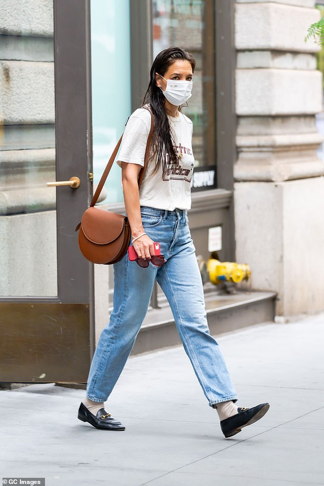 Stepping out: Katie, who was dressed casually in a vintage Jimi Hendrix T-shirt, was seen out after recently ending her relationship with chef Emilio Vitolo Jr