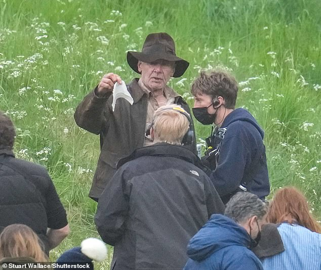 Dedicated: It comes following reports that Harrison has undertaken a gruelling exercise regime while filming the latest Indiana Jones film at Bamburgh Castle in Northumberland