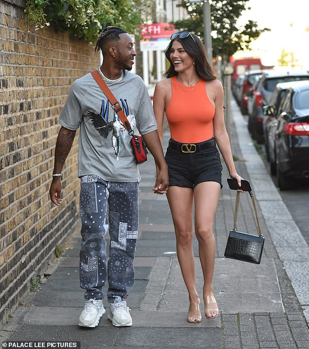 Cute:Rebecca Gormley and Biggs Chris looked more loved-up than ever as they headed to a barbecue in London on Saturday
