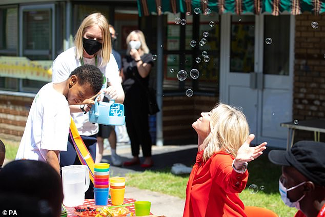 Blowing bubbles: The star threw herself into the fundraising day and blew some bubbles