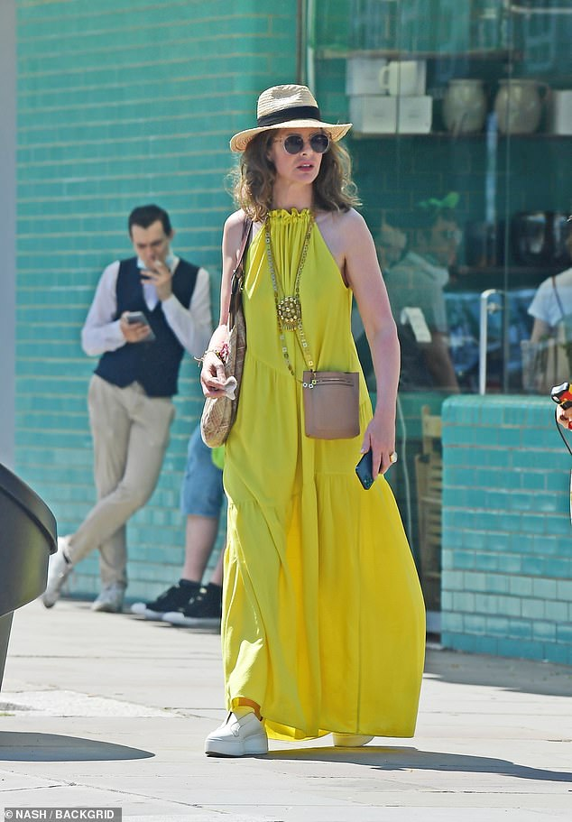 Protection:Trinny fended off the beating sun with a chic straw fedora and made sure to also protect her vision with trendy sunglasses