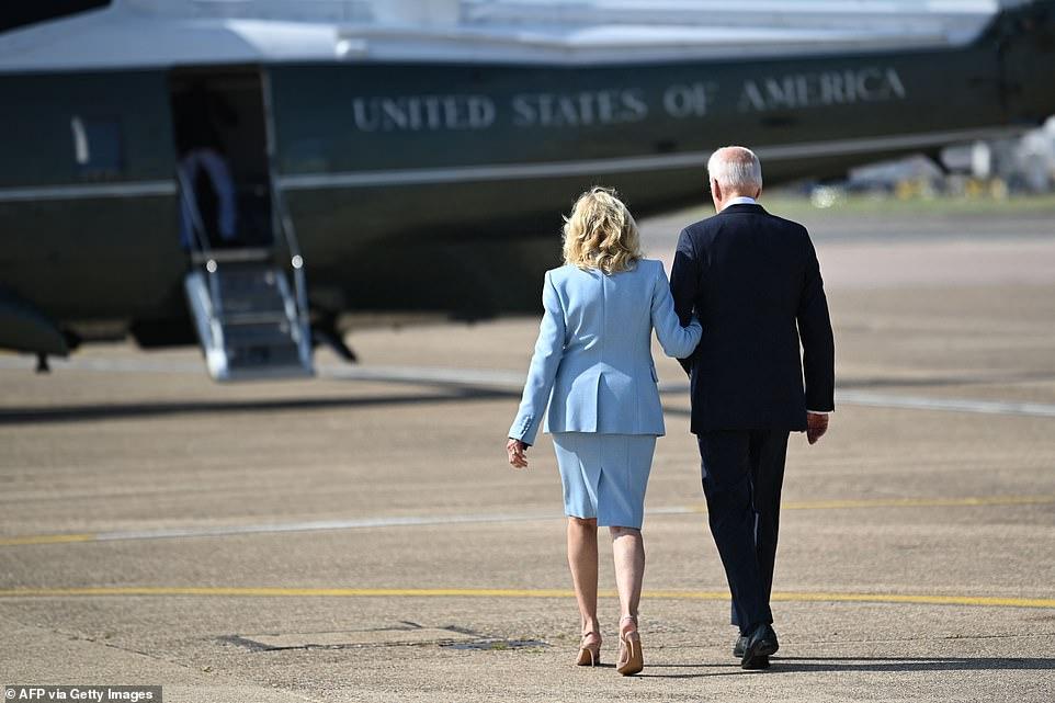 Joe Biden and US First Lady Jill Biden walk towards US helicopter Marine One at Heathrow, west of London, on June 13