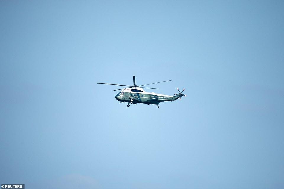 A helicopter flies over Windsor Castle during the arrival of U.S. President Joe Biden and first lady Jill Biden to meet Britain's Queen Elizabeth, in Windsor