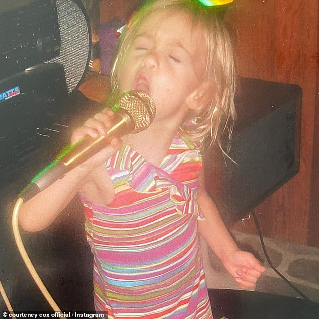 Young talent:The next image was of Coco as a toddler as she crooned into a golden microphone