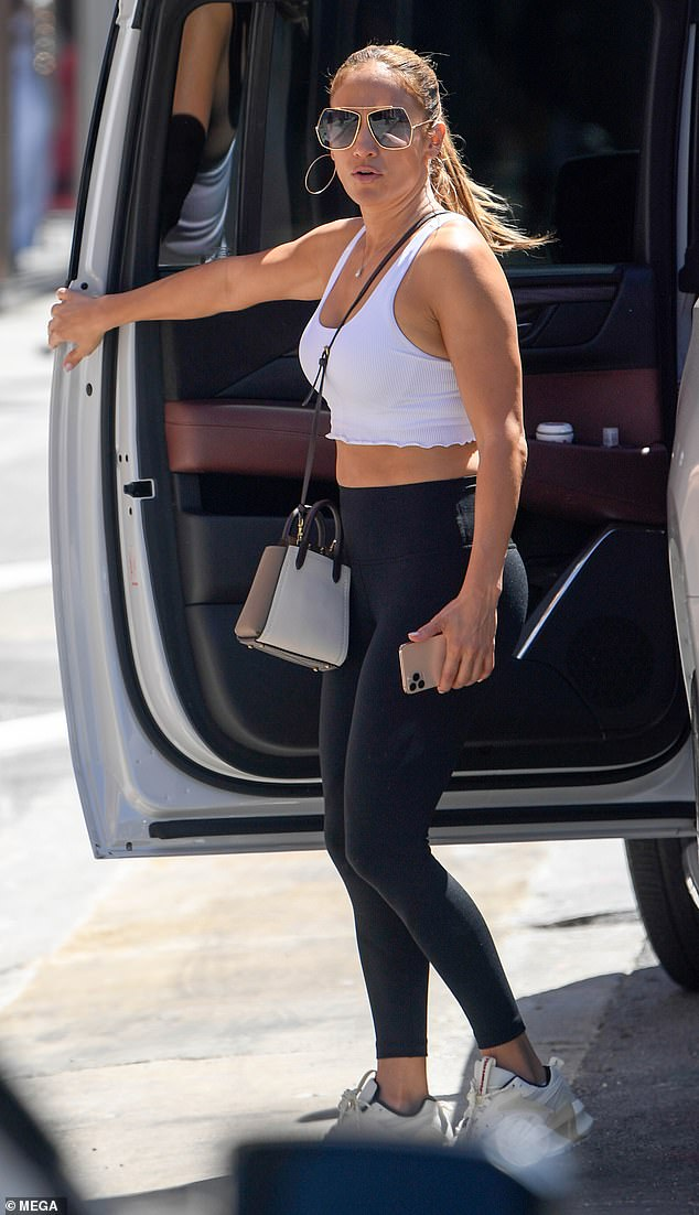 Athletic style: Jennifer Lopez, 51, showed off her ripped arms and fit figure in athleisure while out shopping in Beverly Hills with her 13-year-old daughter Emme