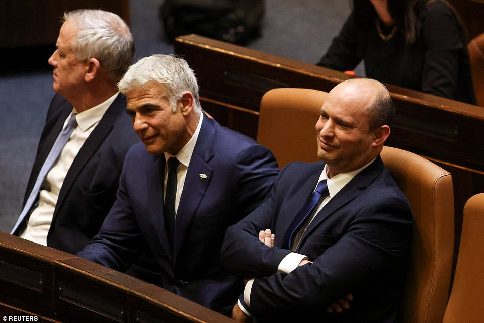 The driving force behind the coalition is Yair Lapid, (centre with Bennett on Sunday in parliament) a political centrist who will become prime minister in two years, if the government lasts that long