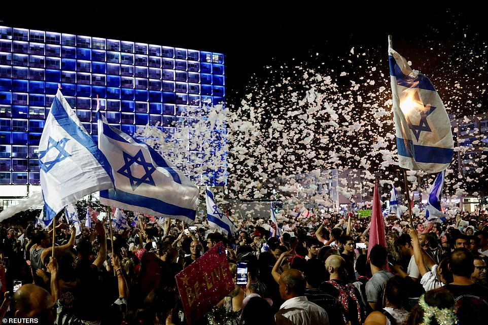 The supporters gathered in Rabin Square in Tel Aviv and had a foam party, with the white foam contrasting with the night sky