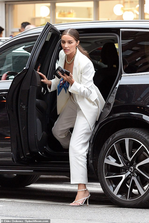 Stop the traffic!  The gorgeous influencer stepped out of her ride in her strappy white heels