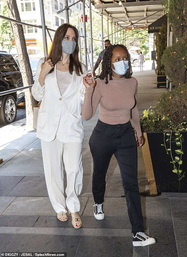 Hand in hand: Angelina Jolie spent some quality one-on-one time with three of her teenage children - including 16-year-old daughter Zahara Marley (R) - on her 46th birthday trip to the Big Apple last Wednesday