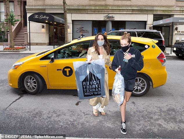 Who needs a limousine?  Later that day, Jolie got out of a yellow cab with 15-year-old Shiloh Nouvel after shopping at Dover Street Market