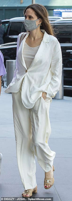The Oscar-winning actress looked sophisticated wearing a white pantsuit over a matching tank top and beige kitten heels.