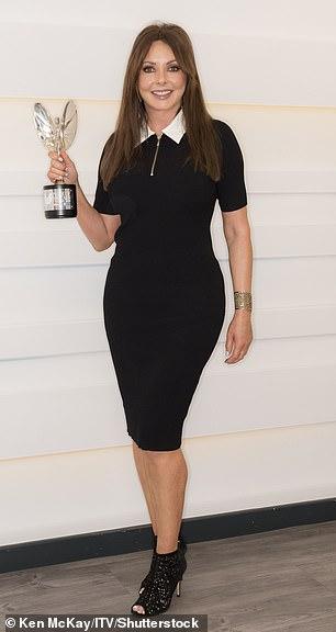 Looking good: Carol looked sensational in a black skintight midi dress and shimmering heels