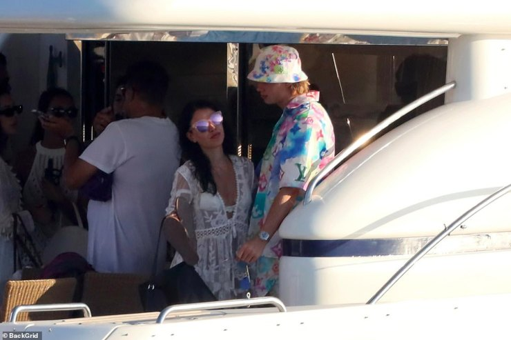 More striking however was the £150million-rated forward's Louis Vuitton 'watercolour' outfit which he wore on the yacht