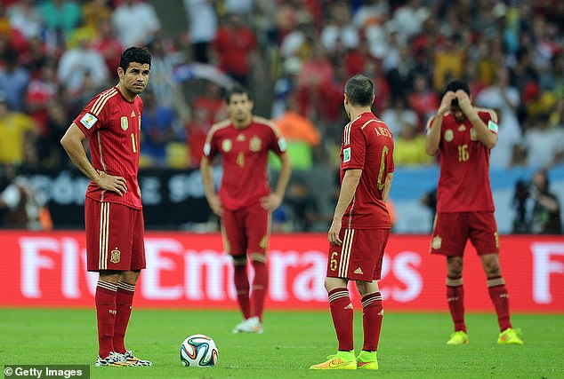 Diego Costa (left) and Spain flopped miserably at the 2014 World Cup, heading home early