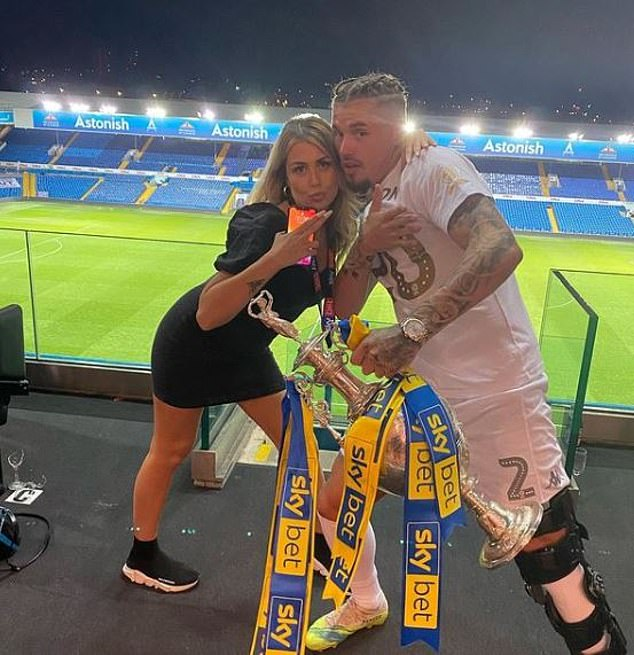 Phillips and Behan celebrating Leeds winning the Championship at Elland Road last summer but they are unable to celebrate the Croatia result together for the time being