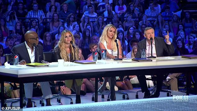 He said: 'I was sitting with Britney for two days, and after every few auditions, she would go…' (before imitating the singer allegedly slumping over the audition table) - pictured 2012 with LA Reid and Demi Lovato)