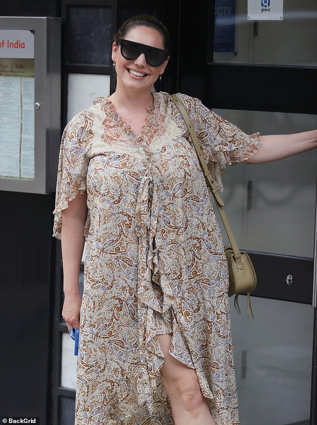 Style: The presenter donned a paisley printed dress and a pair of brown strapped heels as she entered the Global Studios