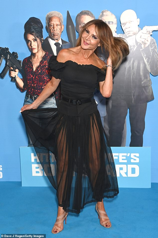 Daring: Lizzy Cundy posed up a storm in a very racy sheer black chiffon skit and towering nude heels