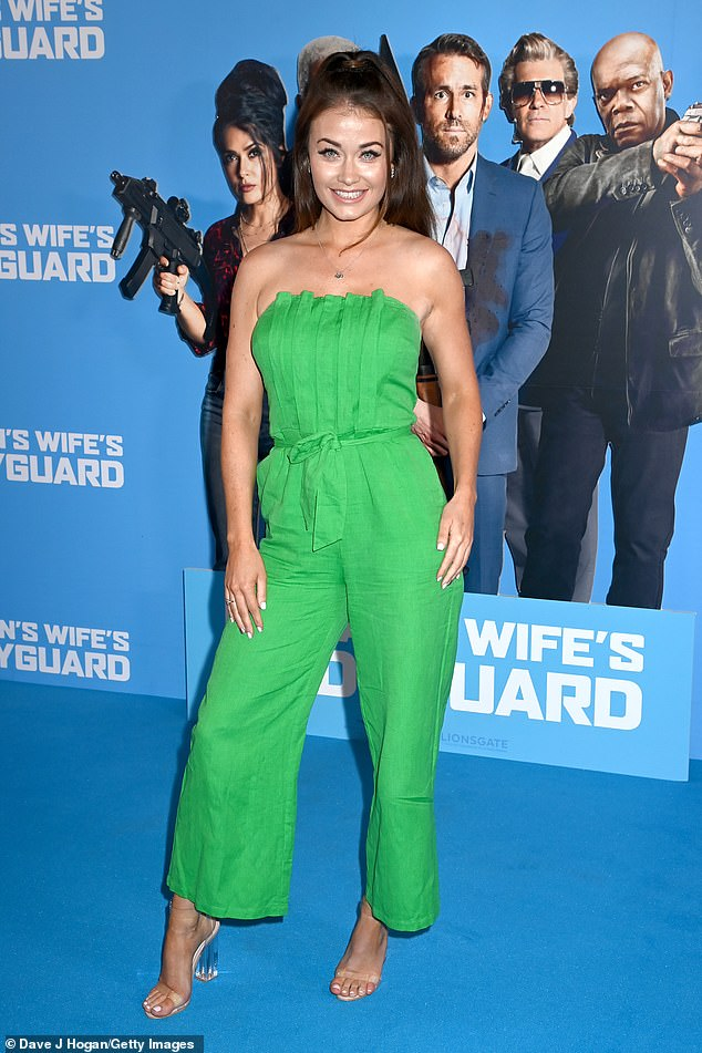 Premiere posing: Actress Jess Impiazzi kept this glamorous in an emerald jumpsuit and perspex heels