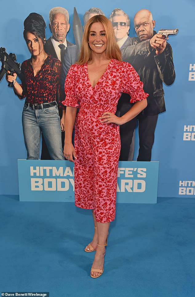 Pink lady: Dancing on Ice professional Alex Murphy looked sensational in a fuchsia floral midi dress and nude stilettos