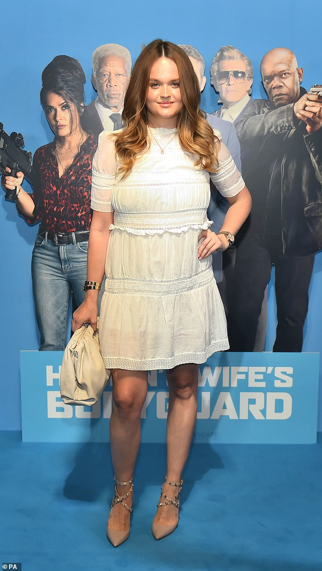 Sweet: Lady Camilla Beresford looked stylish in nude Valentino studded heels and a frilled white knee-length smock dress