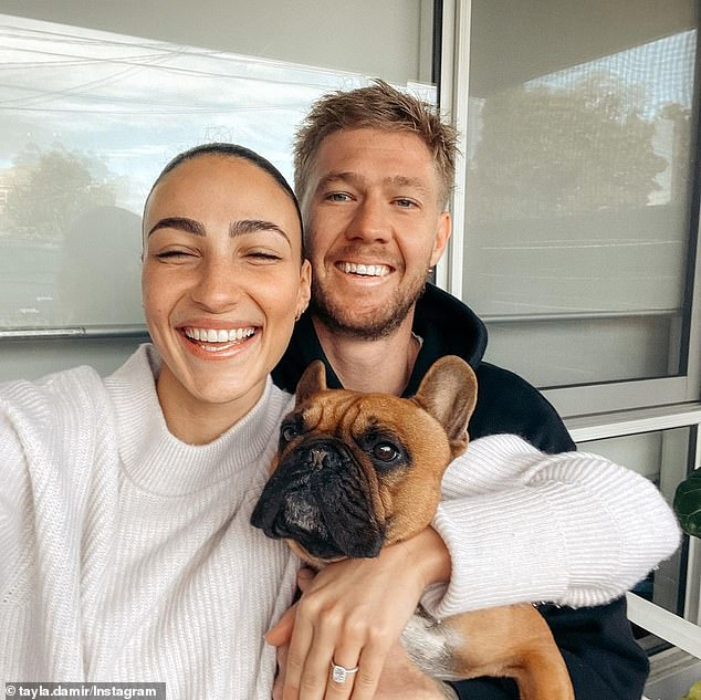 'My forever': The couple broke the news of their engagement on Tuesday, after the three-time AFL premier, 28, proposed at their home in Melbourn
