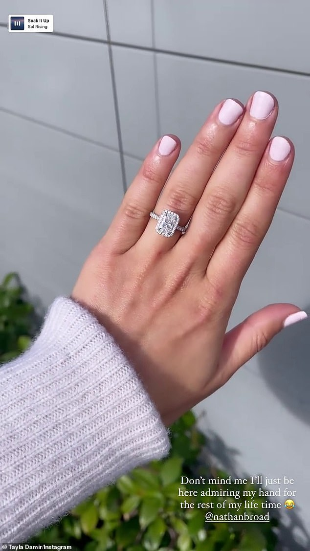 The boy did well!  Tayla Damir flaunted her massive engagement ring after her handsome AFL star Nathan Broad proposed to her over the long weekend