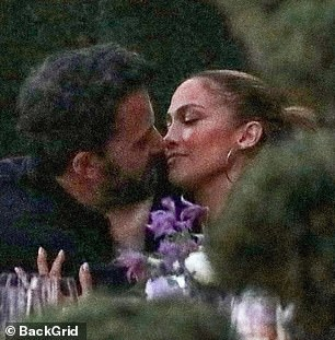 Steamy: Ben Affleck and Jennifer Lopez couldn't keep their lips off of one another during a family dinner at hotspot Nobu in Malibu on Sunday night