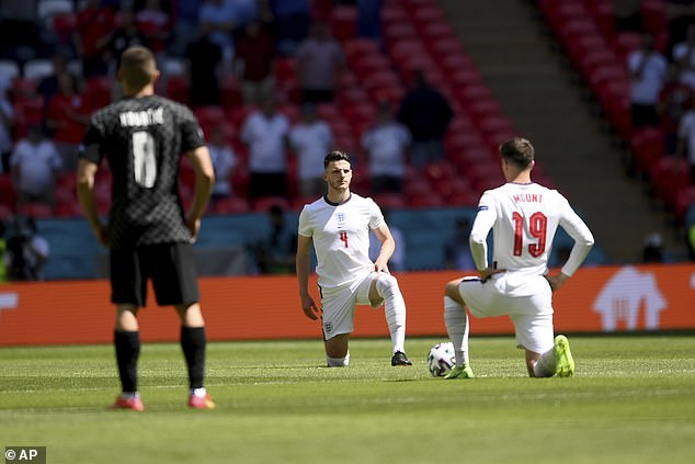 The England team took a knee in the moments before their match with Croatia at Wembley