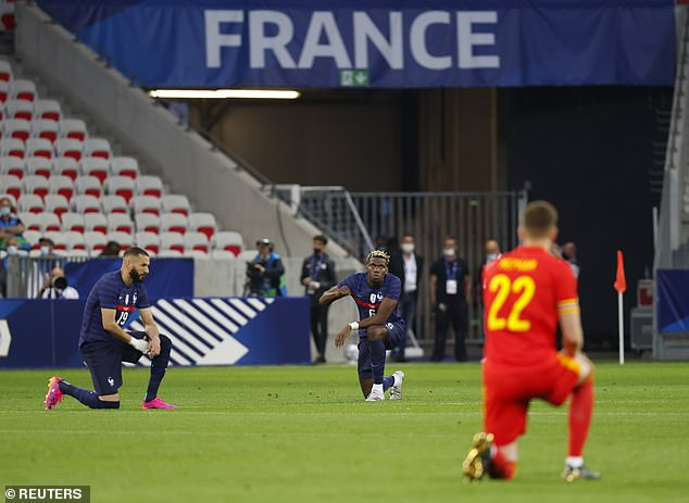 The French players have previously been criticised for taking a knee - here, they are pictured doing so before their Euro 2020 warm-up match against Wales