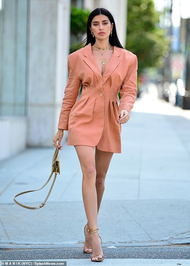 Hot stuff!  Nicole Williams staged a head adjustment as she was seen in a photoshoot in Beverly Hills on Wednesday morning