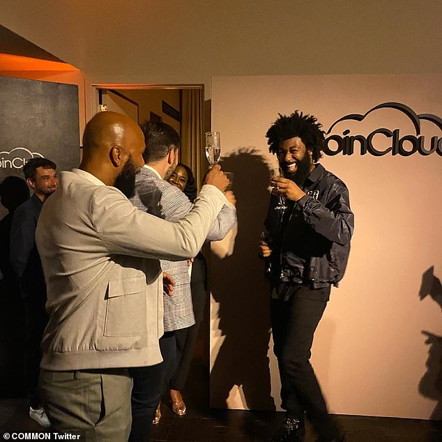 Cheers!  Common shared a snap of himself raising his glass at the party in a tweet congratulating the company on Tuesday