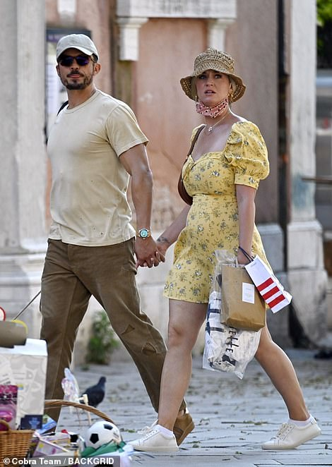 Cozy: He held his future wife's hand as they strolled through the sunny streets