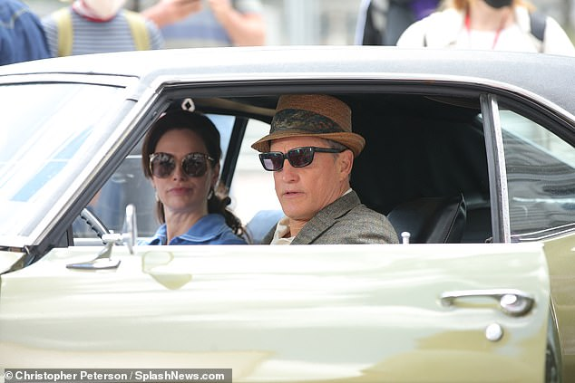Set life: Lena Headey, 42, and Woody Harrelson, 59, continued to travel back in time filming scenes in a vintage Pontiac on the set of HBO miniseries The White House Plumbers in Albany, New York