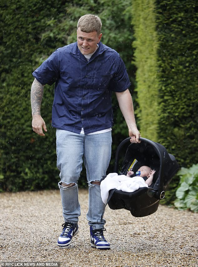 That's my boy: Proud dad carefully carried his son in his car seat