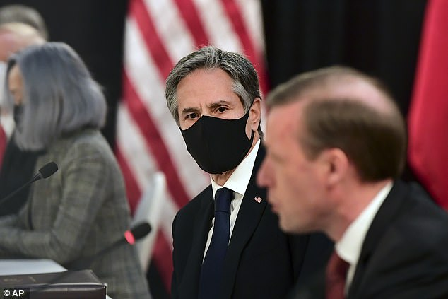 Blinken, pictured with a face mask, refused to hand over Dong, a Chinese dissident reported. The State Department has not confirmed Dong's defection