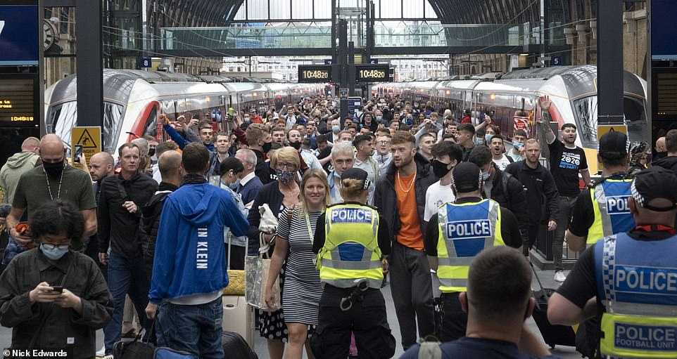 Crowds of people were seen arriving in London. Several train passengers did not wear face masks yesterday