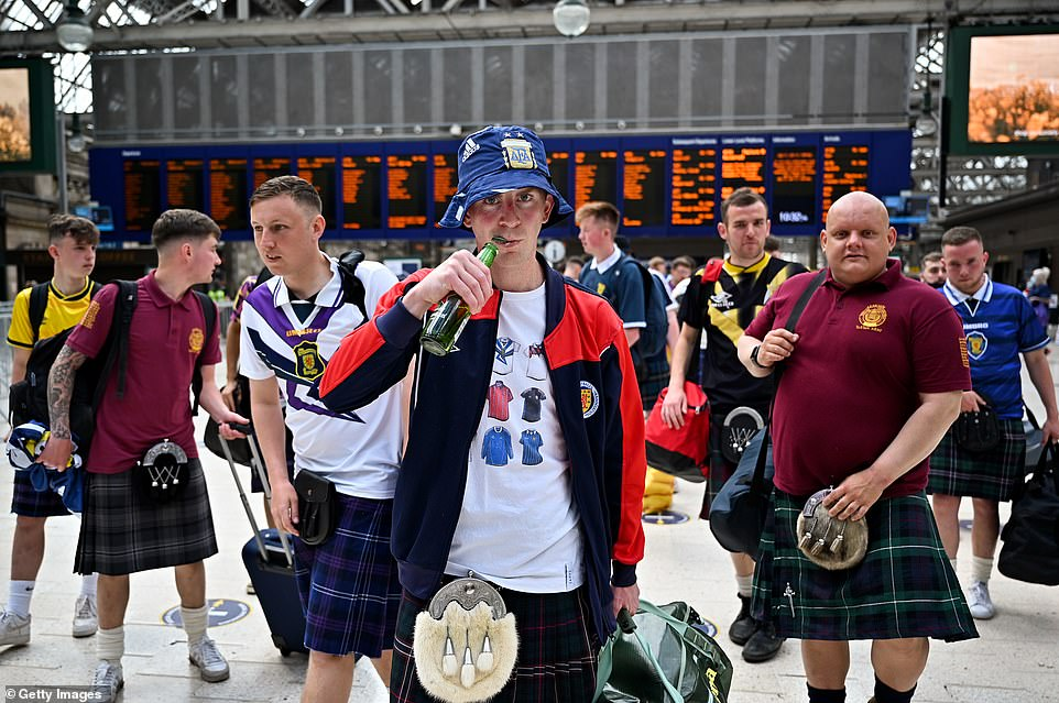 Fans were seen holding bottles of beer and clutching suitcases ahead of boarding trains to London yesterday