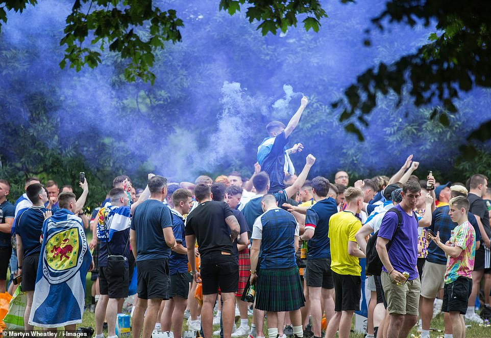 Scottish football fans arrive in London yesterday for the European Championship clash with England at Wembley Stadium
