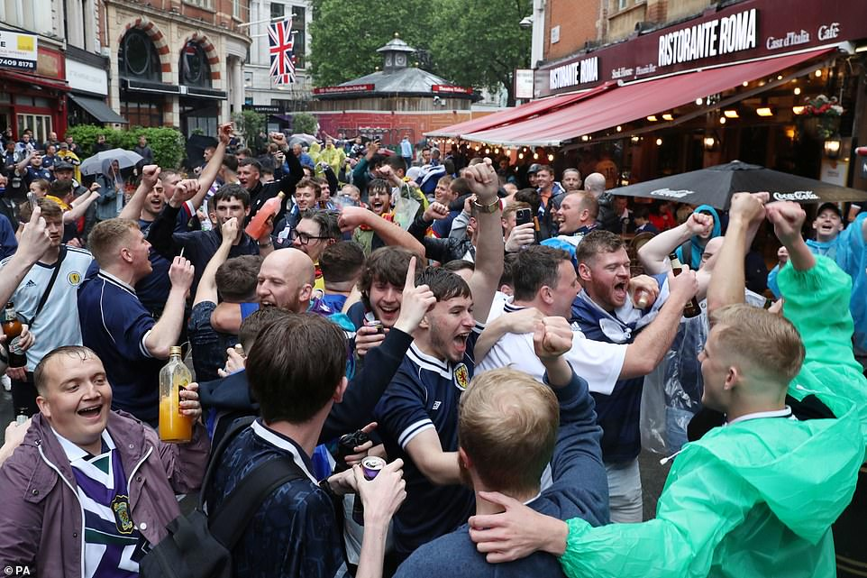 The Tartan Army on the march, as Scottish fans mass in Leicester Square today after the festivities of the previous night