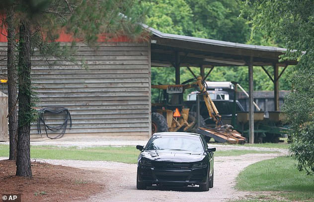 The bodies were said to be found near a dog kennel on the family's property on June 7