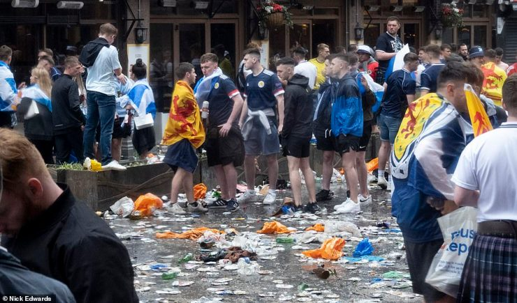 The supporters left huge piles of litter in the popular London square with cans and bottles strewn across the floor after fans moved on