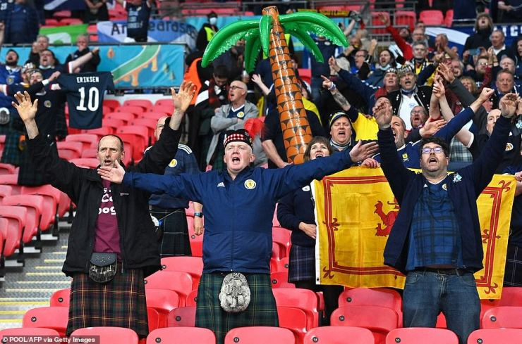Scotland supporters who made the nation-wide trip from north of the border sing in the stands at Wembley in central London