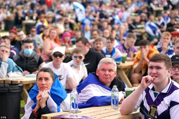 Fans watch the England/Scotland clash at the fan zone in Glasgow. They look nervous but their side got off to a strong start and surprised some pundits
